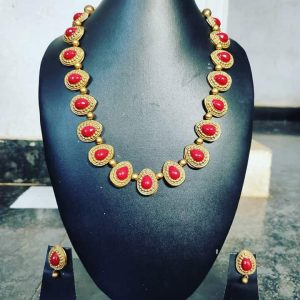 TERRACOTTA HANDMADE INDIAN DESIGNER JEWELRY Necklace with Earings in Golden Base Leafs with Red Studded Stones