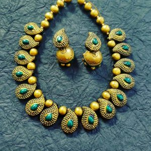 TERRACOTTA HANDMADE INDIAN DESIGNER JEWELRY Necklace with Drop Earings in Golden Yellow Base Leafs & Beads with Green Studded Stones